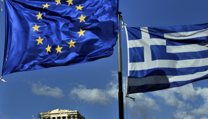 The European and the Greek flags fly abo